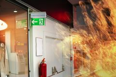 Emergency fire exit sign and fire in shopping mall Stock Photo