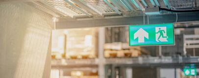 Free Emergency Fire Exit Sign Show The Way To Escape At The Public Area, Warehouse Store Stock Photography - 191290232