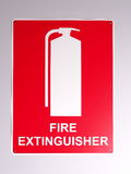 Emergency fire extinguisher wall sign Stock Photos