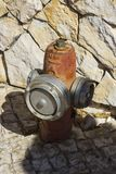 An emergency fire hydrant located in front of a stone wall in Albuferia in Portugal. Stock Images