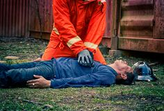Emergency Fire Rescue training, Firefighters save unconscious ma royalty free stock images