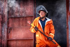 Emergency Fire Rescue training, firefighters in uniform, arm wit royalty free stock images