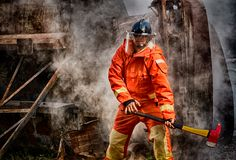 Emergency Fire Rescue training, firefighters in uniform, arm wit stock images