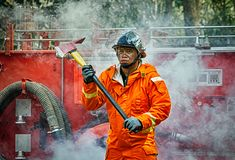 Emergency Fire Rescue training, firefighters in uniform, arm wit stock photography