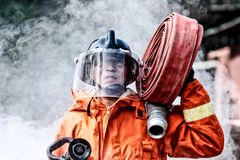 Emergency Fire Rescue training, firefighters in uniform, carry royalty free stock photos