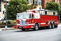 Emergency fire truck. Washington June 2017 US: Emergency truck across the streets of Washington downtown, Rescue Squad 1 with bright shining signs and Stock Photos