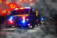 Emergency Firefighter Truck and Blaze Fire Flames. Emergency firefighter rescue truck with flashing lights at disaster night scene of an inferno blaze fire with Stock Images