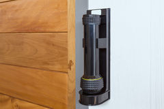 Emergency flashlight at door for urgent case Stock Photo