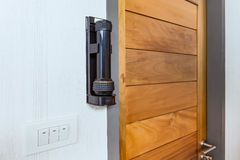Emergency flashlight at door for urgent case Royalty Free Stock Photo