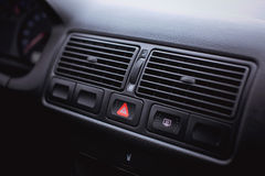Emergency gang button and the air conditioner grille close up. Royalty Free Stock Photo