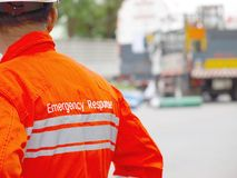The emergency respond person at the emergency situation of accident. The emergency guy stay nearly the emergency situation of car accident stock photography