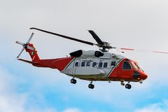 Emergency helicopter flying over the sea royalty free stock photography