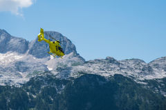 Emergency helicopter hovering over the mountains Royalty Free Stock Images