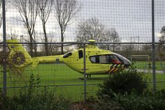 Emergency helicopter landed on a soccer field to rush to an accident in the Netherlands royalty free stock photos