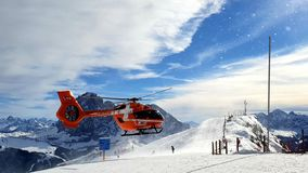 Emergency helicopter on ski slopes royalty free stock image