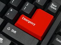 Emergency key. Closeup of computer keyboard key in red color spelling Emergency royalty free stock photos