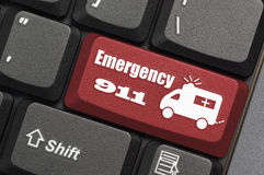 Emergency 911 on keyboard. Red emergency 911 key on keyboard Stock Photos
