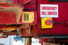 Emergency Kill Switch Safety Feature. Machinery safety features - emergency kill switch and pinch point labels on a drill rig Stock Photo