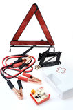 Emergency kit for car. First aid kit, car jack, jumper cables, warning triangle, light bulb kit royalty free stock images