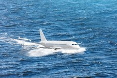 Emergency landing of the airplane on water with splashes. Concept of aircraft rescue, flight safety.  stock photos