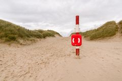 Emergency Life Ring on a Beach. Life ring or life buoy at the entrance to a public beach stock photos