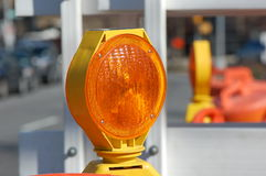 Emergency Light. A bright orange emergency light warns drivers of construction on the road ahead Stock Images