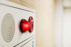 Emergency light wall panel. And alarm speaker sound in the office building stock photography