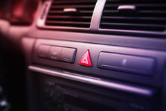 Emergency lights button inside a car. Front panel of a car, with emergency lights button in the center. Zoom effect royalty free stock image