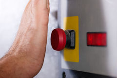 Emergency – Man shutting machine of Royalty Free Stock Photos