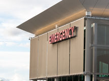 Emergency Medical Center Building Sign Health Care Hospital. Emergency trauma center big red sign royalty free stock photos