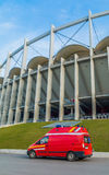 Emergency medical rescue van parked near the modern building of National Arena in Bucharest Stock Photography