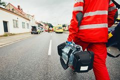 Emergency medical service. Hand of the doctor with defibrillator. Teams of the Emergency medical service are responding to an traffic accident Stock Photo