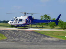 Emergency Medical Services Chopper. EMS Chopper preparing for take off for transfer to a larger hospital after a car accident Royalty Free Stock Photos