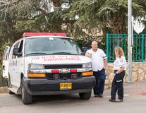 Emergency medical workers stand and talk in anticipation of the start `Cristmas Run` in Mi`ilya in Israel Stock Images