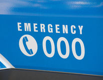 Emergency number 000 on an ambulance royalty free stock image