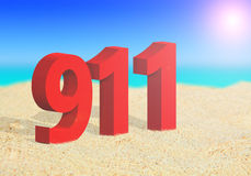 911 emergency number on the beach. Closeup of 911 emergency number on the beach Royalty Free Stock Photo
