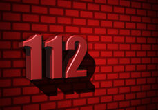 112 emergency number on dark wall. 112 emergency number on dark red wall Stock Photo