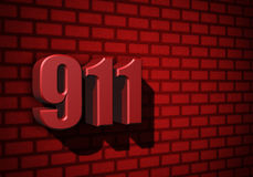 911 emergency number on dark wall Royalty Free Stock Image
