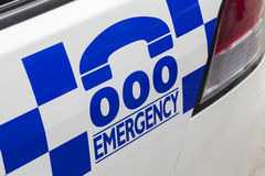 Emergency number 000 on a police car. Emergency number 000 in Australia on a police car Royalty Free Stock Photo