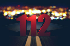 112 emergency number standing on the road. By night stock illustration
