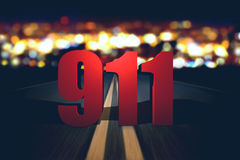 911 emergency number standing on the road. By night Stock Photo