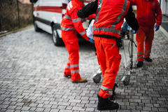 Emergency operators in action. With ambulance after fatal accident Royalty Free Stock Photos
