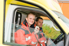 Emergency paramedic in ambulance car talk radio Royalty Free Stock Images