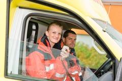 Emergency paramedic in ambulance car talk radio. Smiling confident royalty free stock images