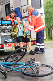 Emergency paramedics helping woman bike accident Stock Image