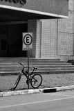 Emergency parking space. Bike parked bellow emergency parking space transit board Stock Image