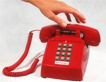 Emergency phone. Hand reaching for emergency phone Stock Image