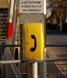 Emergency Phone. A bright yellow phone for use in emergencies royalty free stock photo