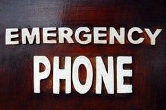 Emergency phone inscription Stock Photo