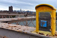 Emergency phone in Manhattan New York. NEW YORK - OCT 11:An old yellow emergency phone on Brooklyn Bridge on Oct 11 2010. After 9/11 terror attacks Lower royalty free stock photography